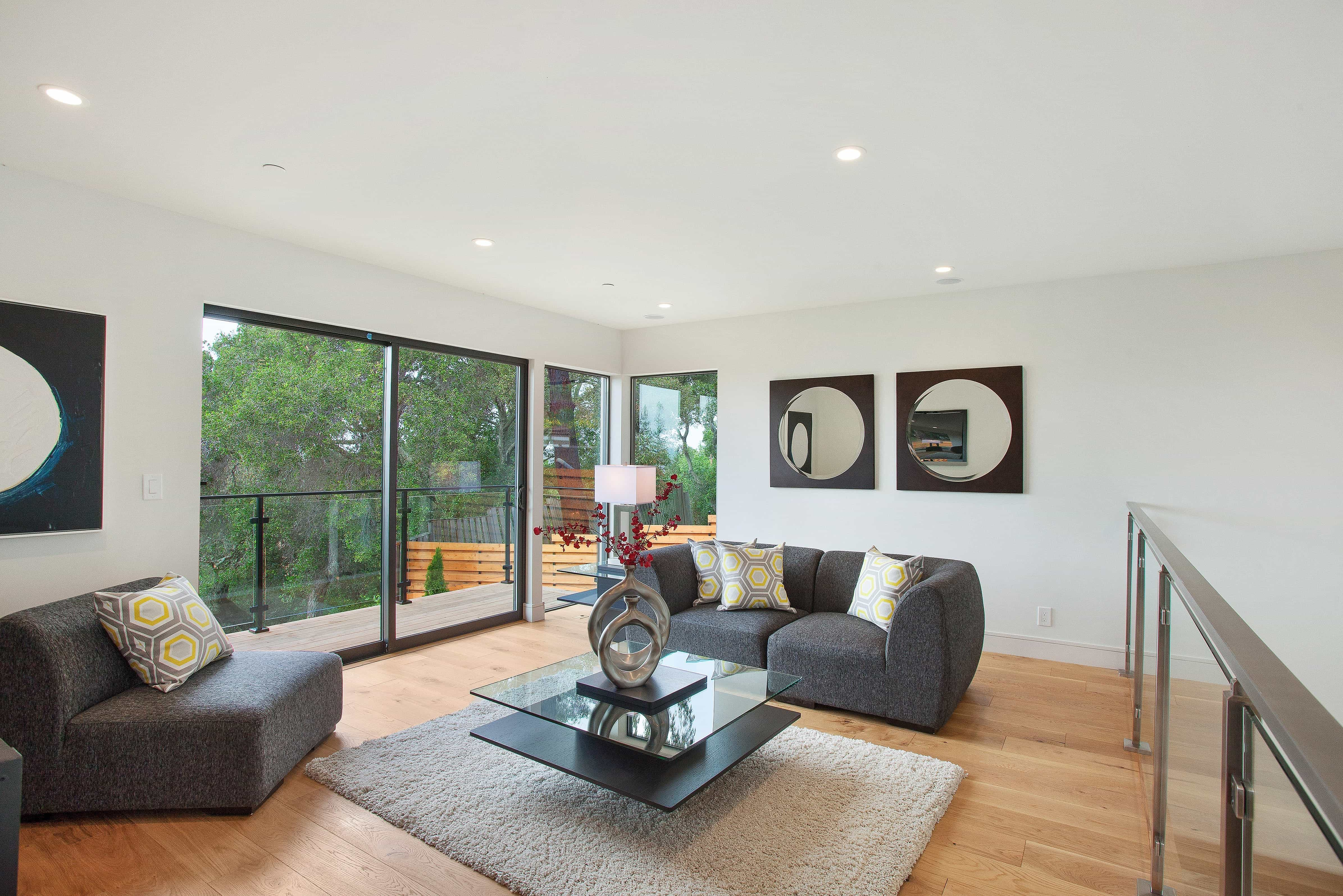 Modern Sitting Room Features Large Sliding Glass Doors (Image 20 of 27)