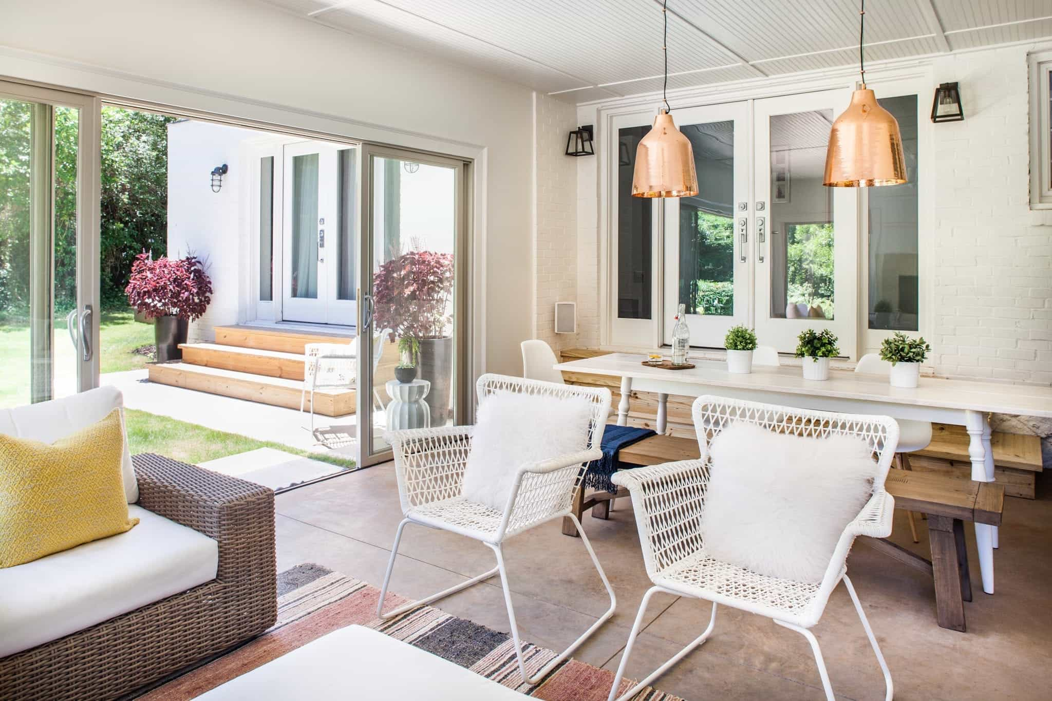 Featured Image of Outdoor Space With White Furniture And Sliding Glass Door
