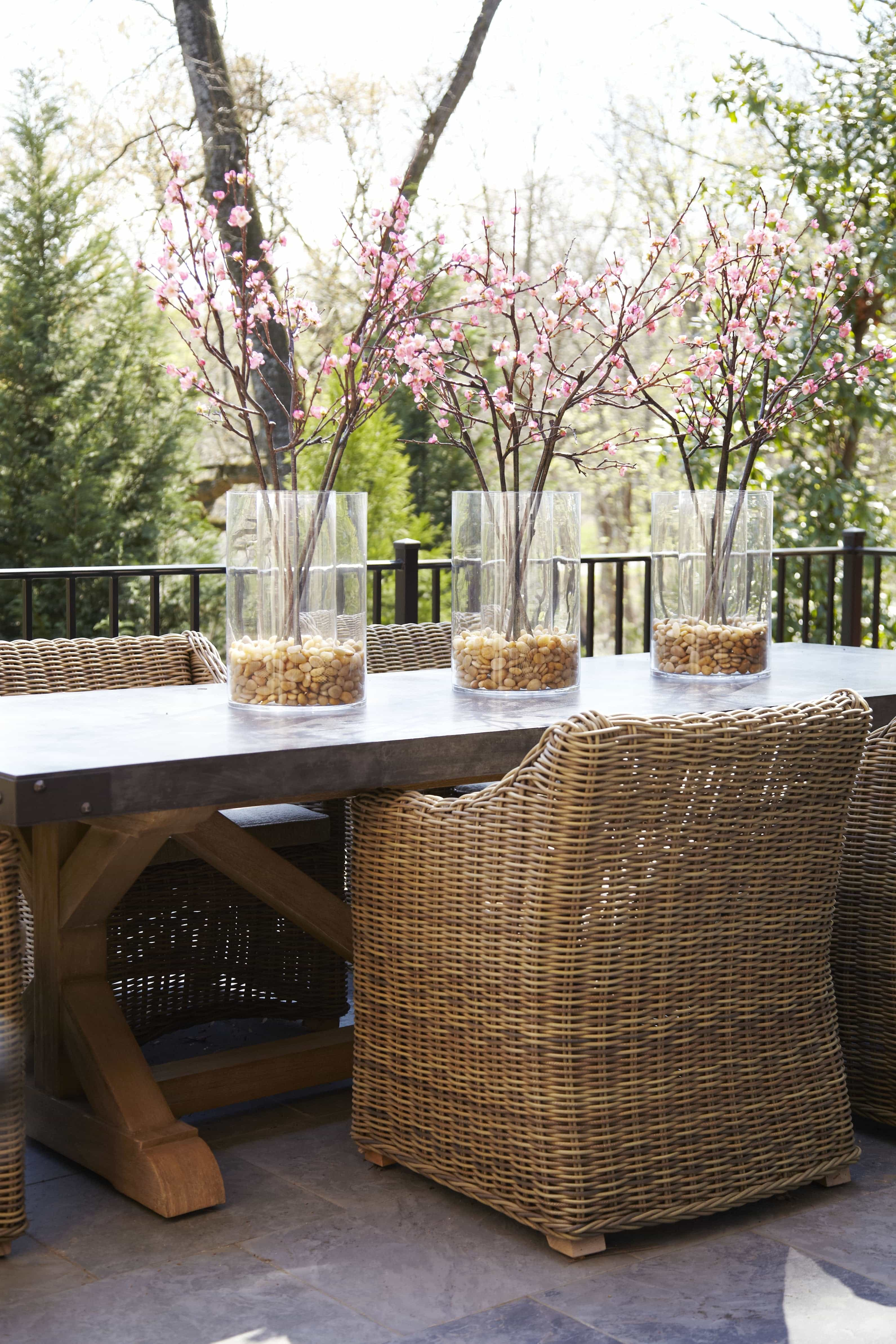 Featured Image of Pink Cherry Blossom Centerpieces And Wicker Armchairs Outdoor Dining