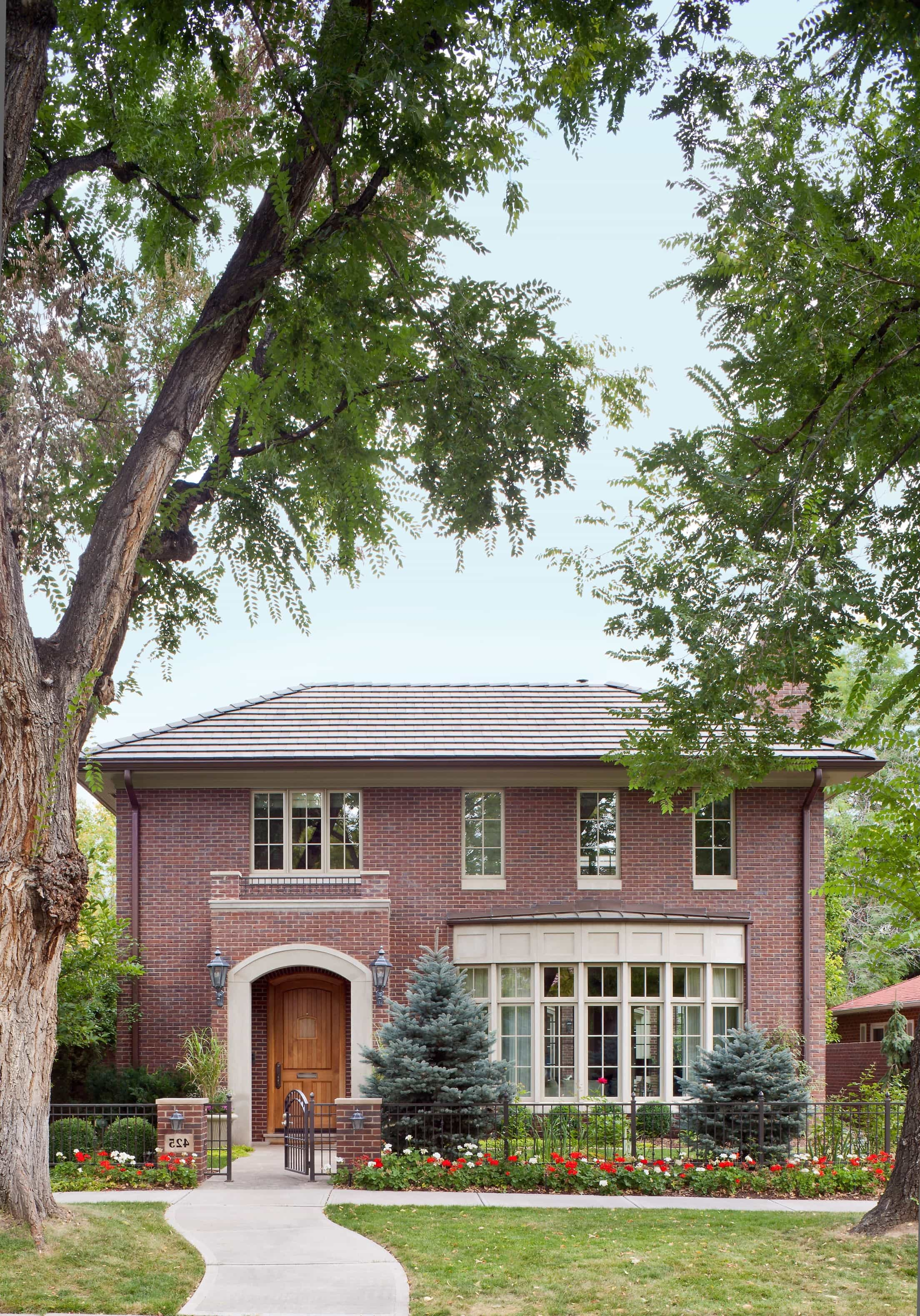 Featured Image of Red Brick House Exterior With Pediment Framing In The Front Door