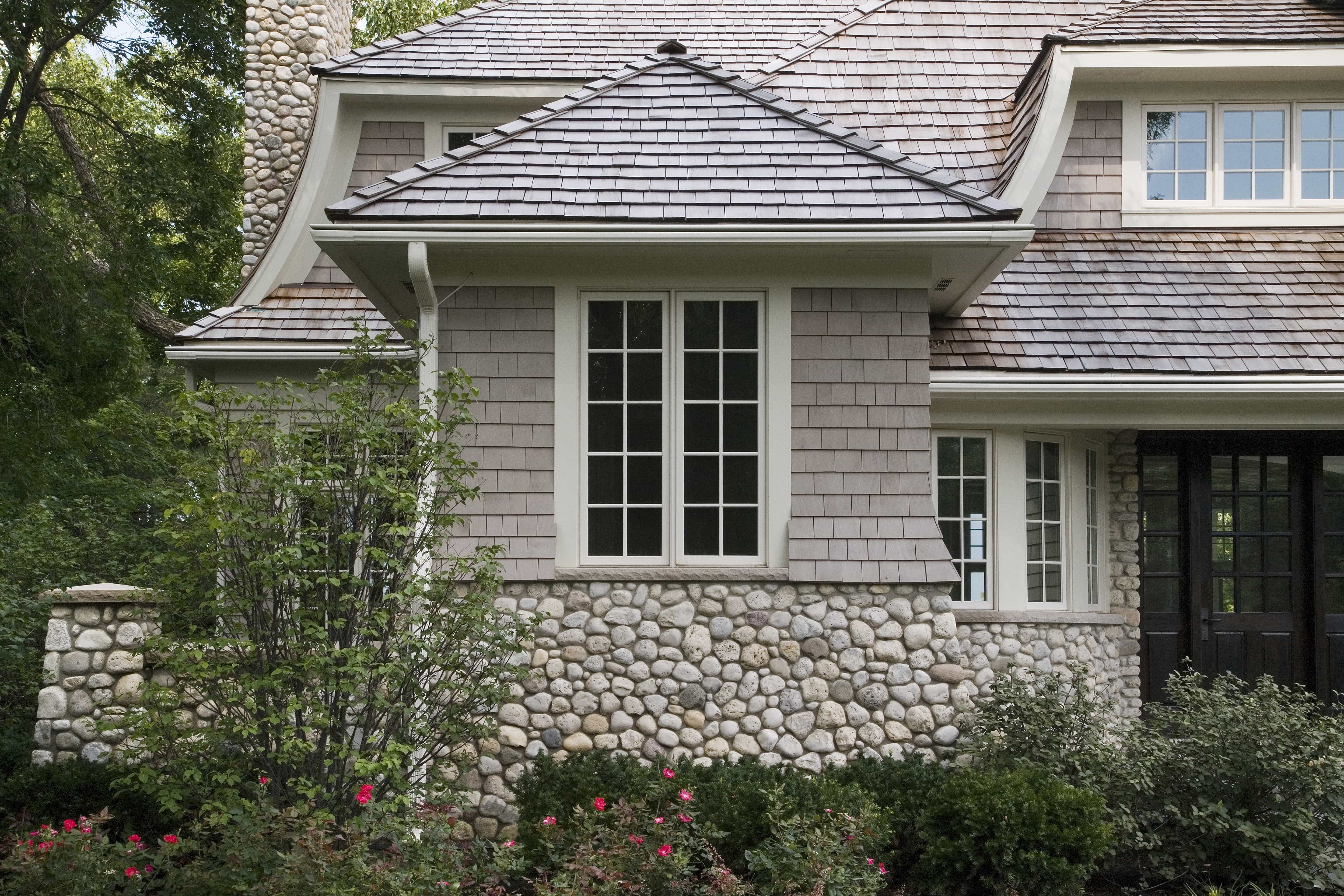 Featured Image of Shingle And Stone Siding Paired With A Cedar Shingle Roof