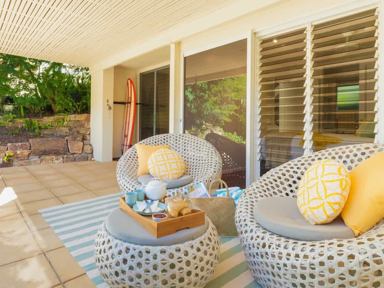 Featured Image of Small Patio With Seafoam Blue Striped Rug Under Woven Bubble Furniture