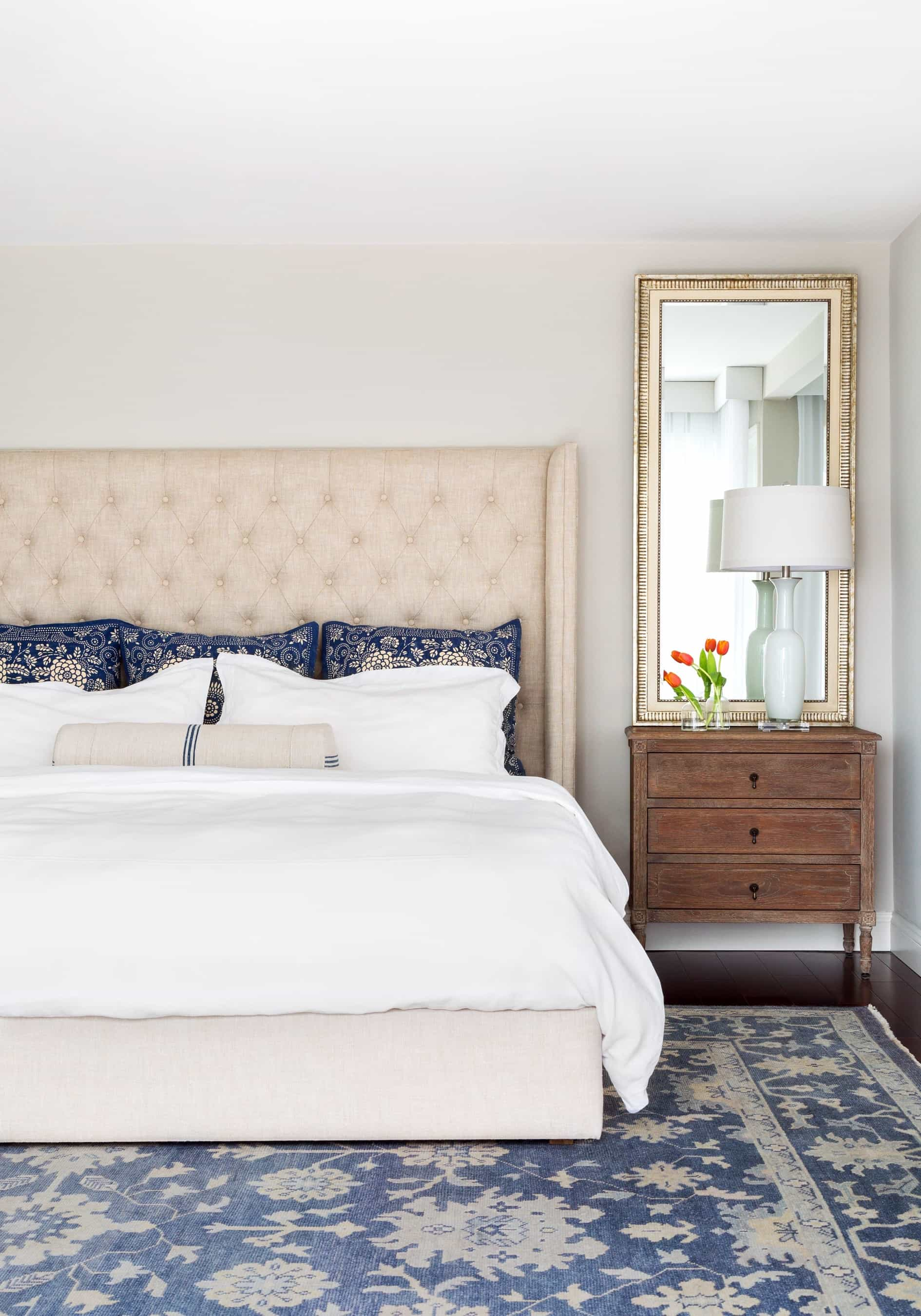 Traditional Bedroom With Upholstered Headboard And Antique