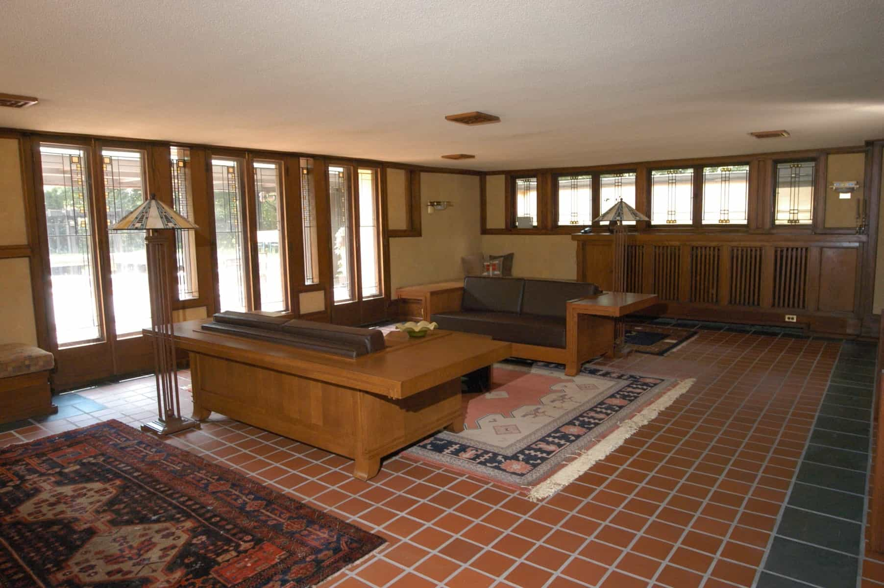 traditional craftsman living room with wood framed windows and