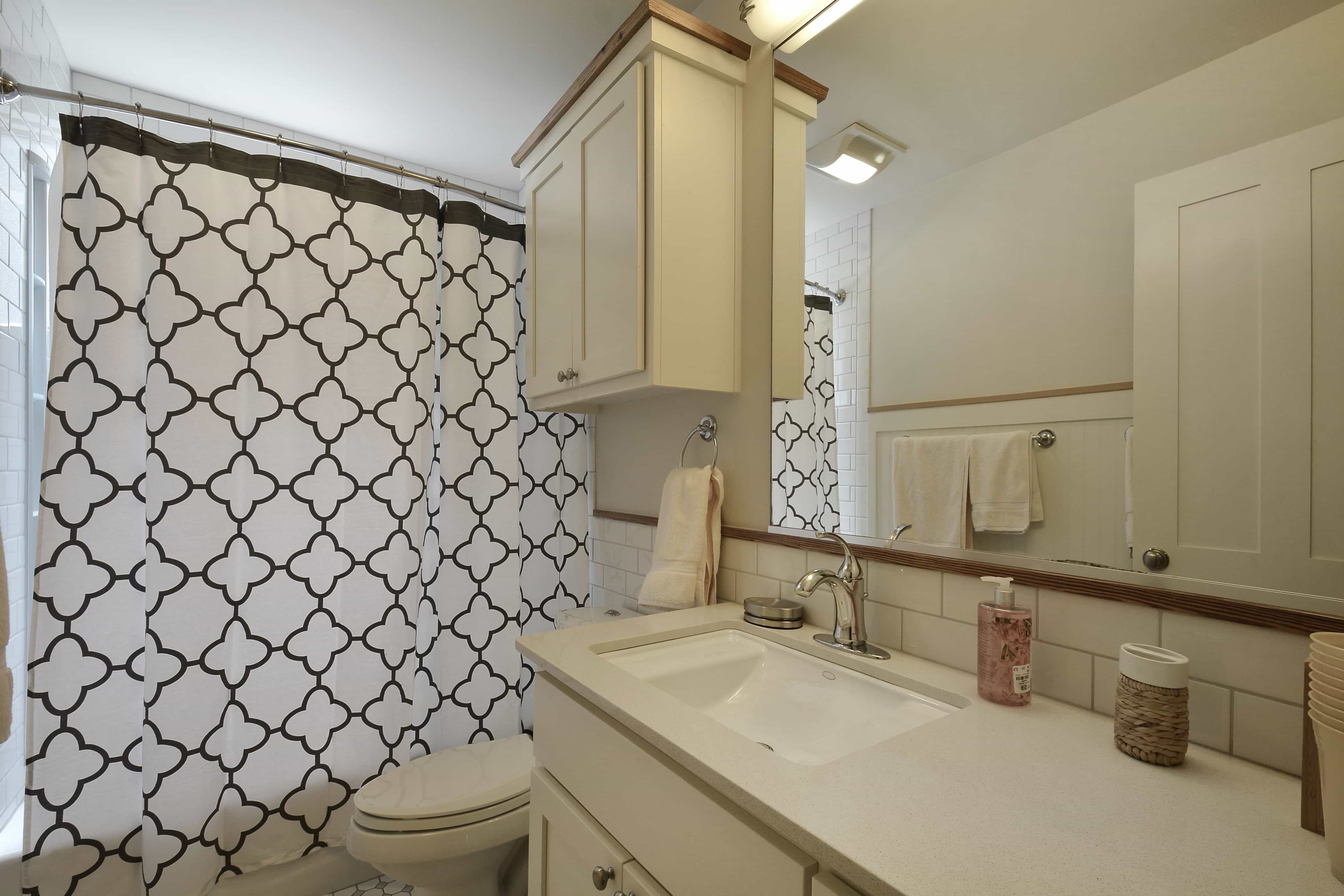 Transitional Bathroom Boasts Moroccan Print Shower Curtain (View 1 of 14)