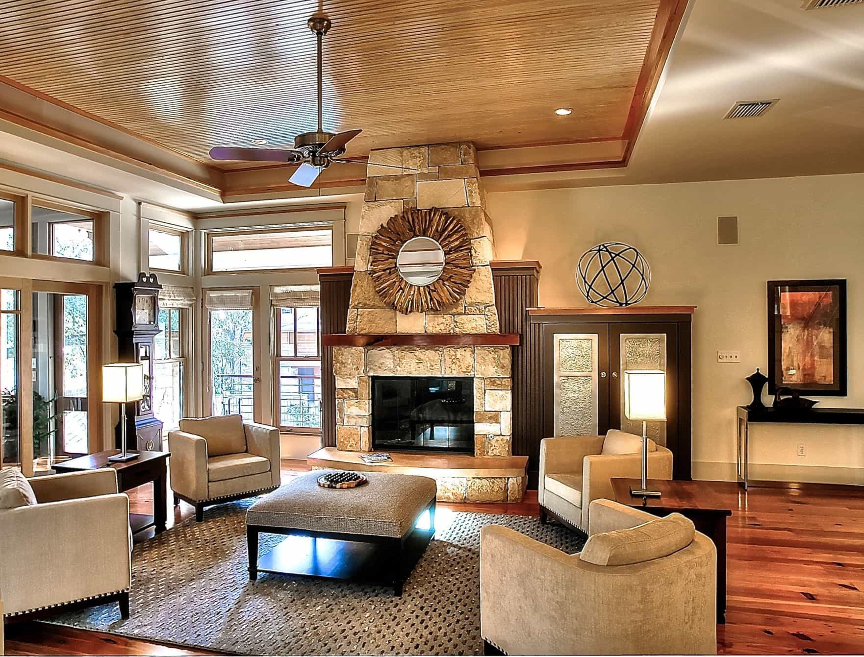 Tray Ceiling And Stone Fireplace For Modern Living Room