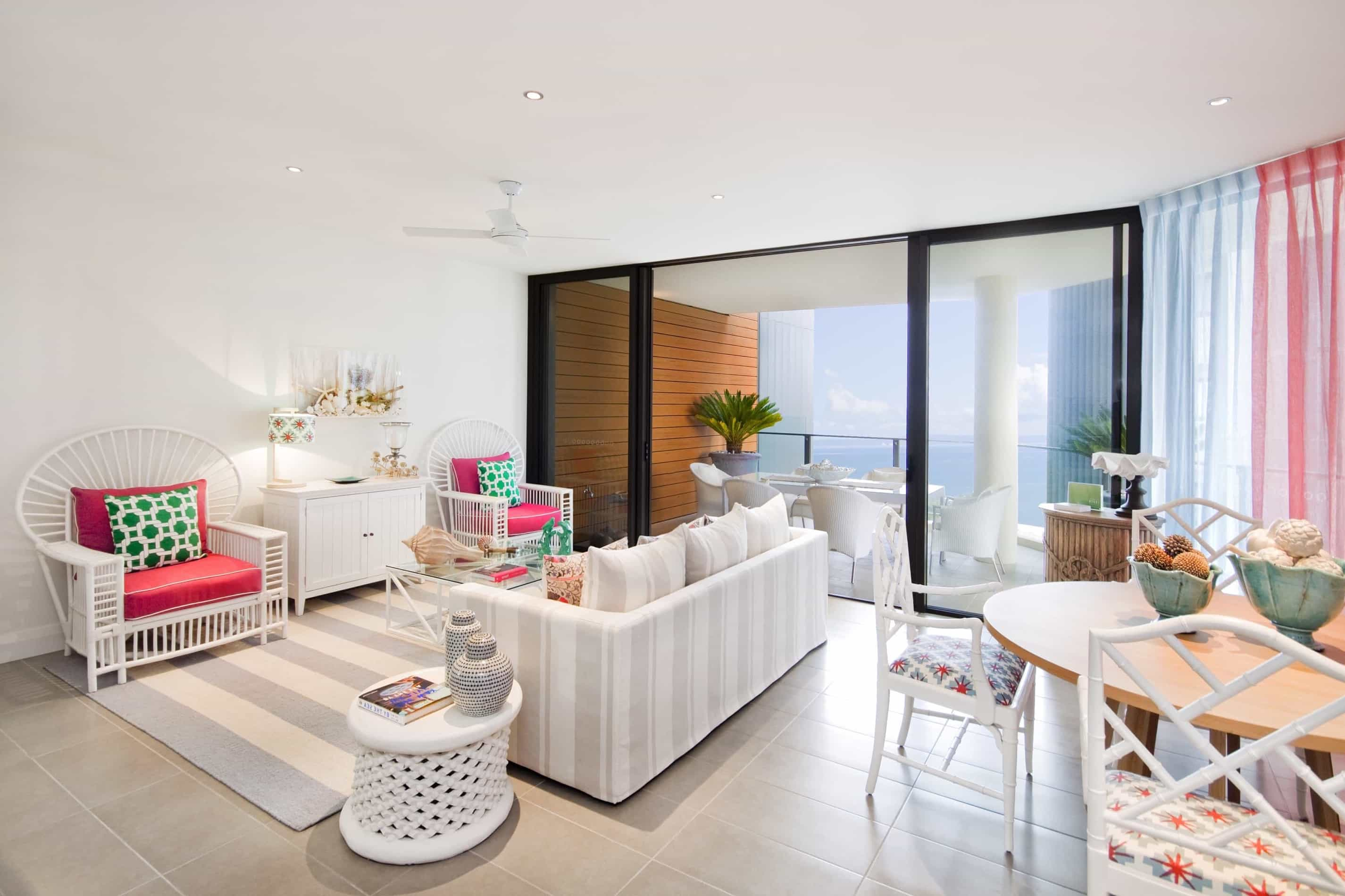 Featured Image of White And Pink Coastal Living Room With Black Framed Sliding Glass Doors