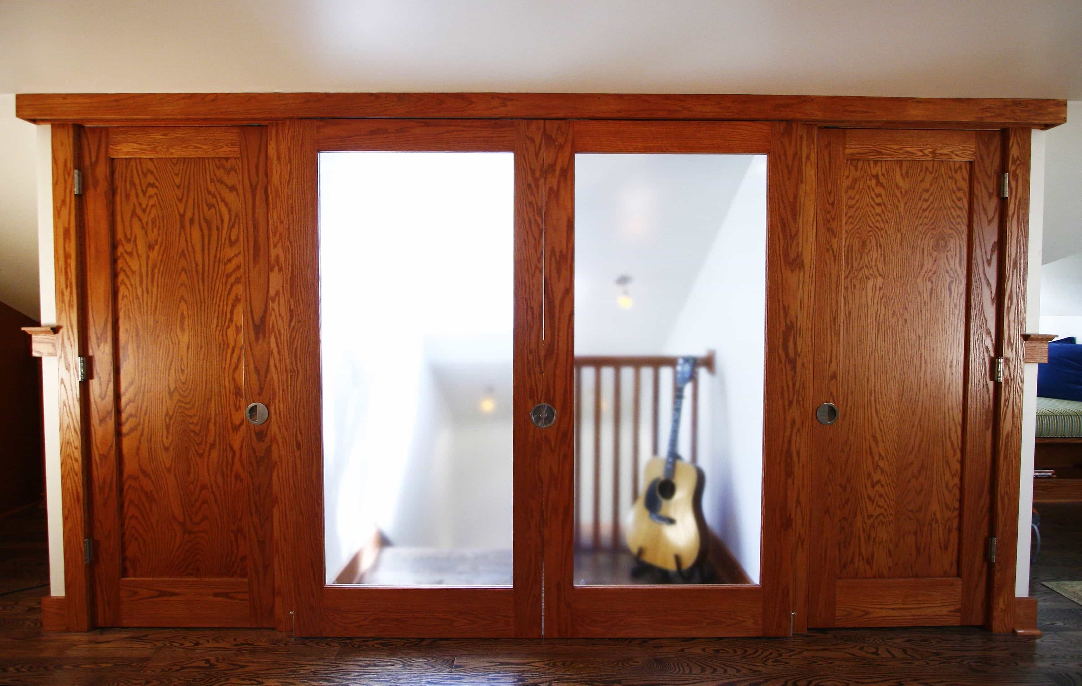 Featured Image of Wood Closet Doors Flank The Frosted Glass Sliding Doors