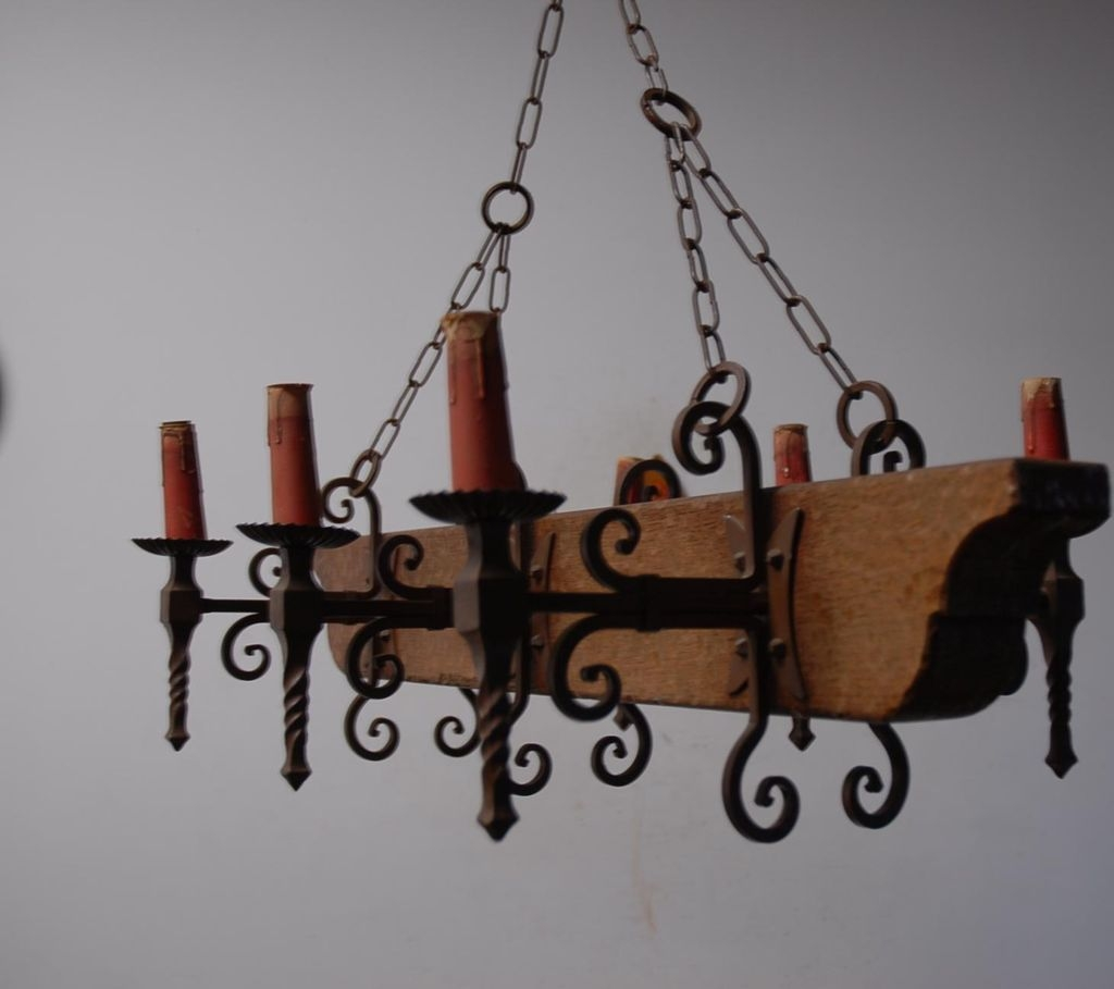 A French Vintage Wood Wrought Iron 6 Light Castle Chandelier With Cast Iron Chandelier (Image 1 of 15)