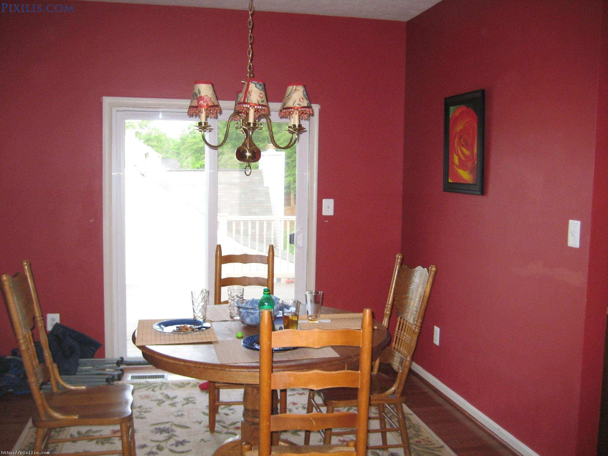 Astounding Red Wall Painted With Rounded Wooden Dining Table Set Pertaining To Small Red Chandelier (Image 5 of 15)