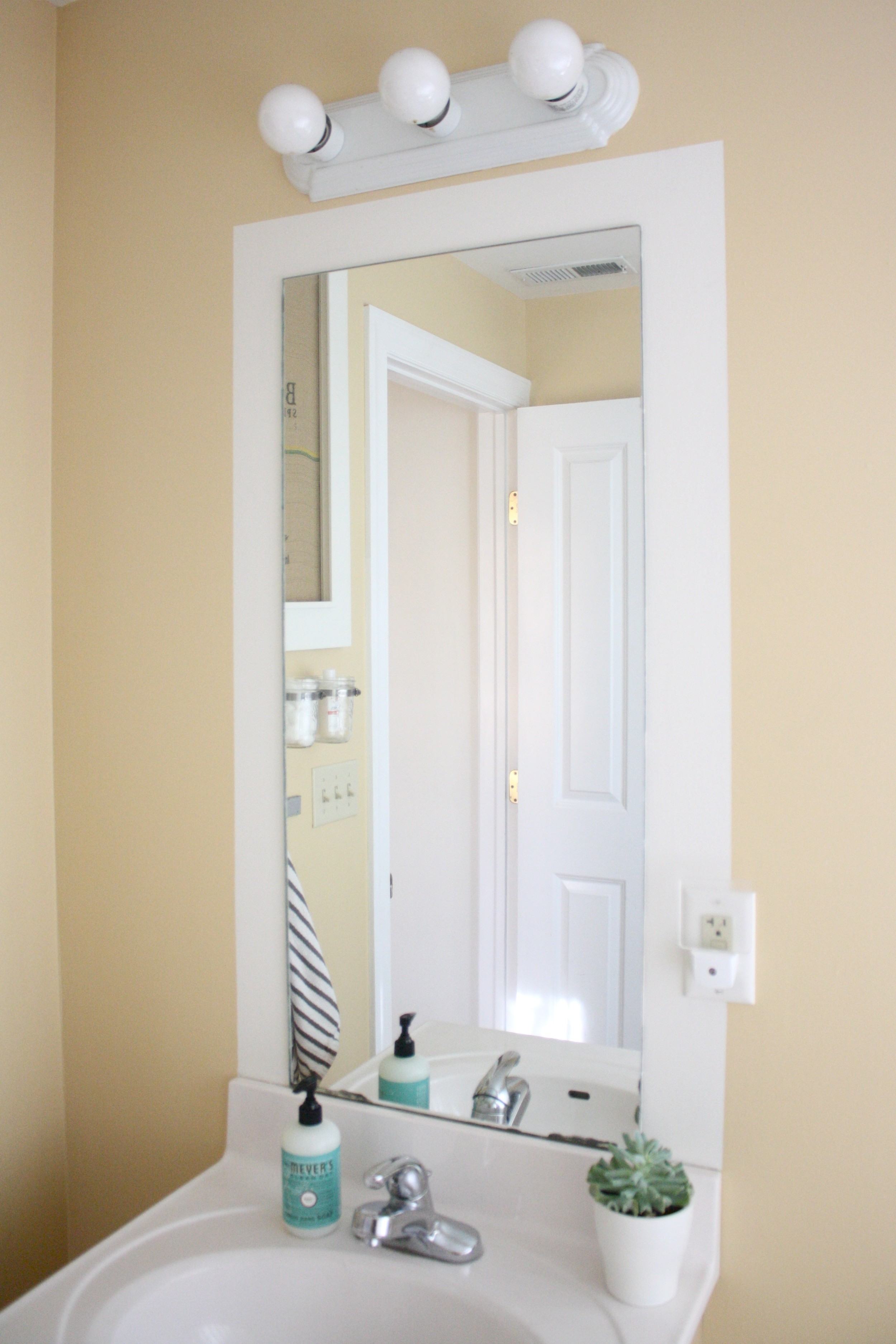 Bathroom Bathroom Furniture Framed Wall Mirrors And Black Wooden Within Cream Wall Mirror (Image 2 of 15)
