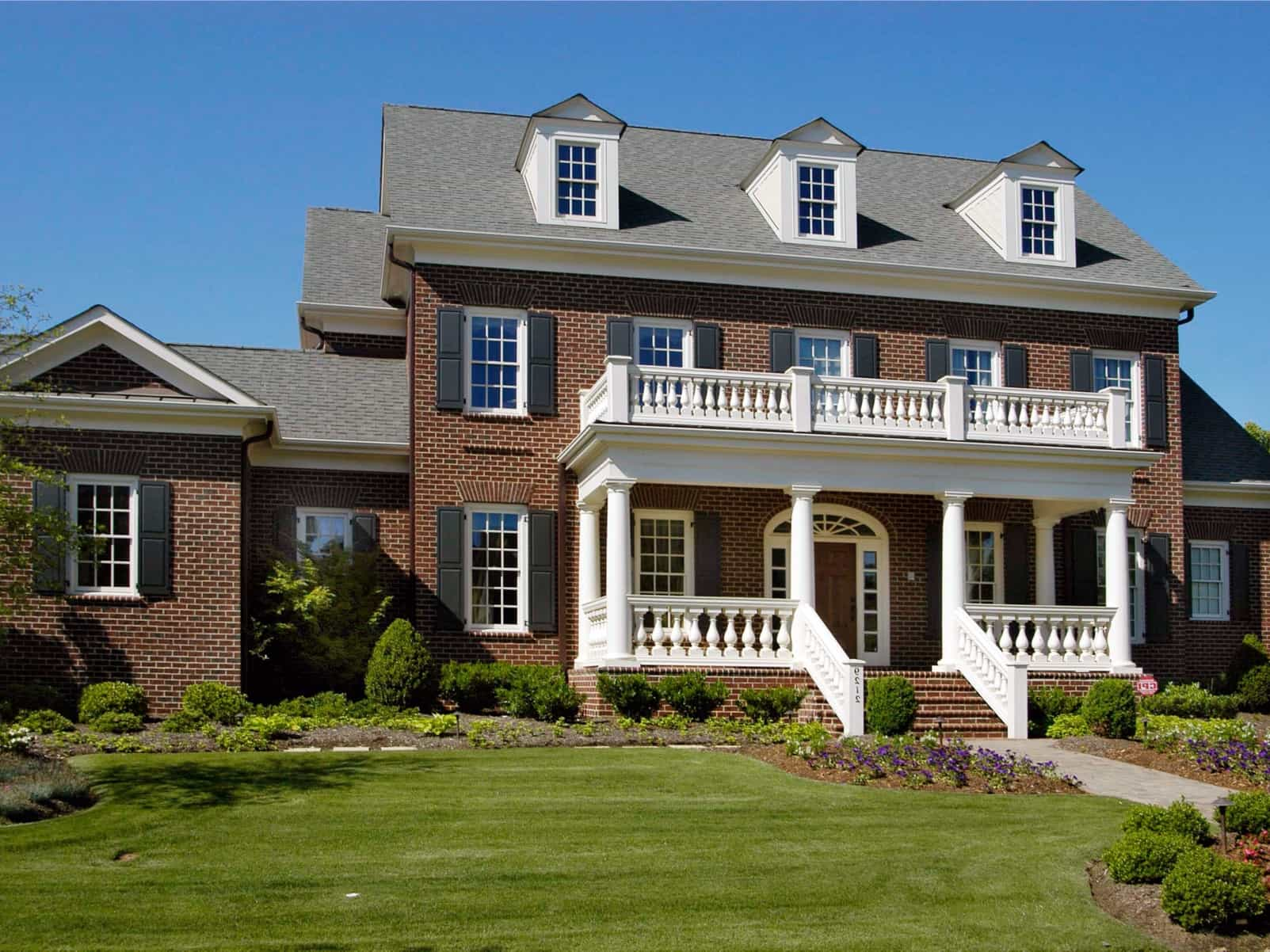 Brick House Architecture With White Pillars For Front Porch And ...