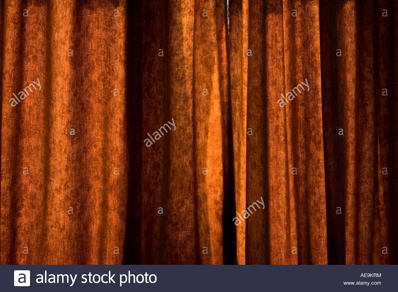 Brown Orange Velvet Curtains In Sunlight Stock Photo Royalty Free Throughout Orange Velvet Curtains (View 9 of 15)