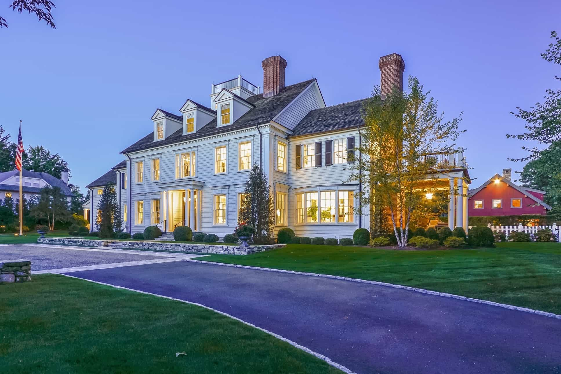 Featured Image of Classic Colonial Home With Gray Shingle Roof And Red Brick Chimneys