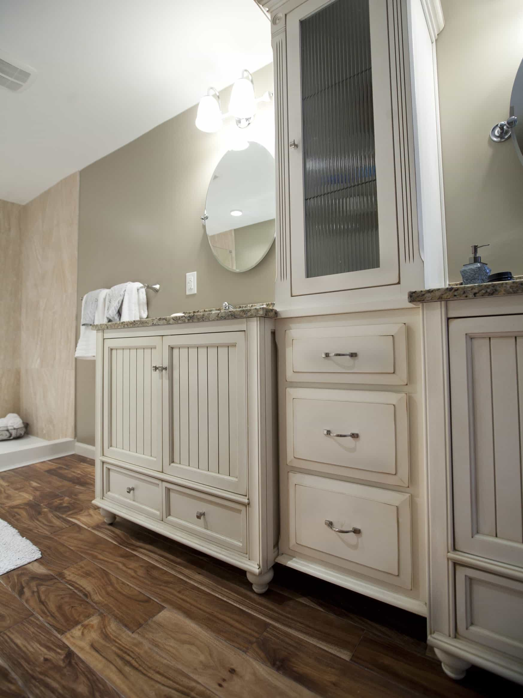 Featured Image of Cottage Twin Vanities With Round Mirrors And Cabinet Lighting