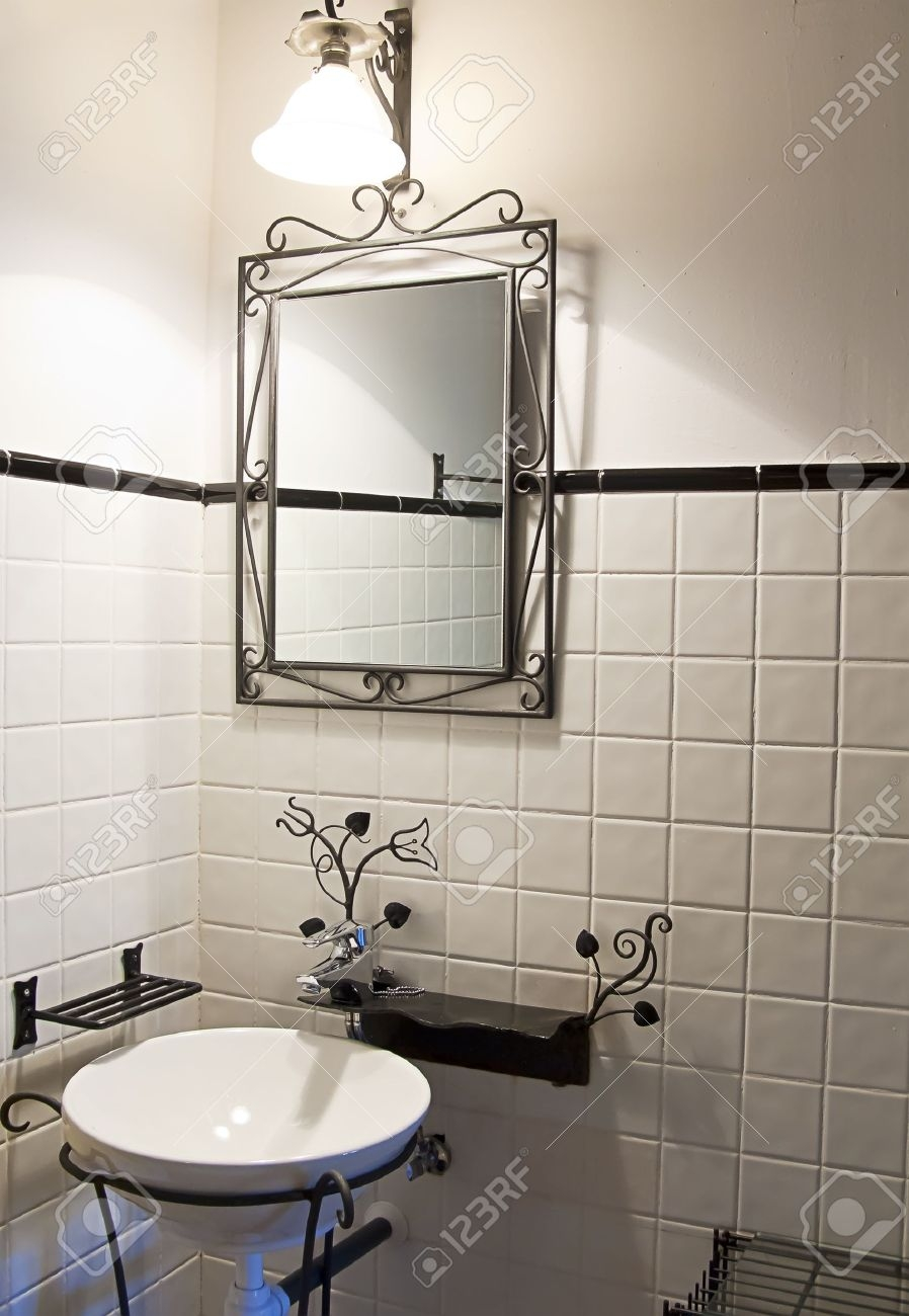 Empty Bathroom Decorated In A Retro Style Stock Photo Picture And Intended For Vintage Style Bathroom Mirror (Image 4 of 15)