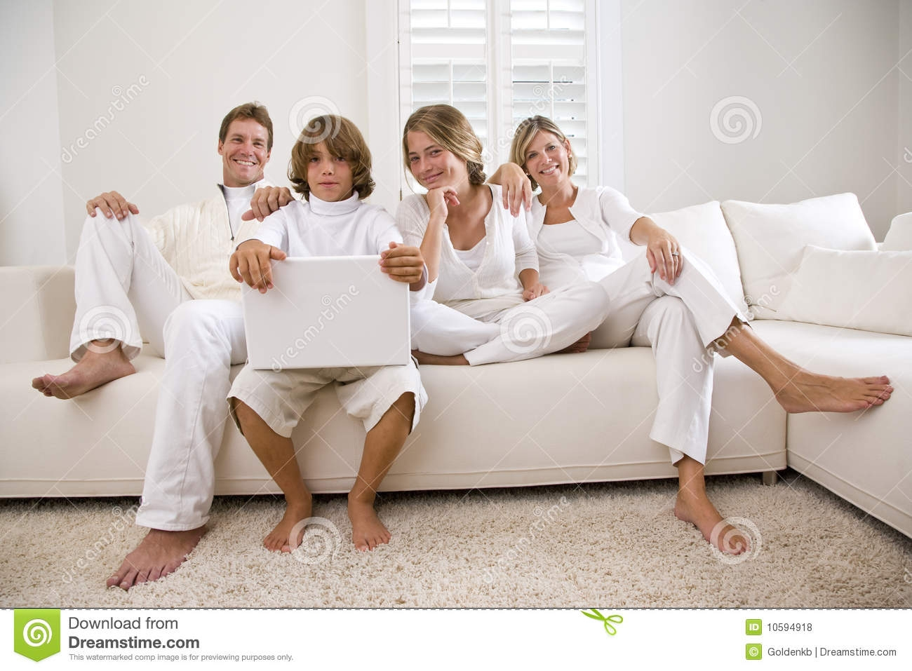 Family Relaxing At Home On White Living Room Sofa Royalty Free With Family Sofa (Image 4 of 15)