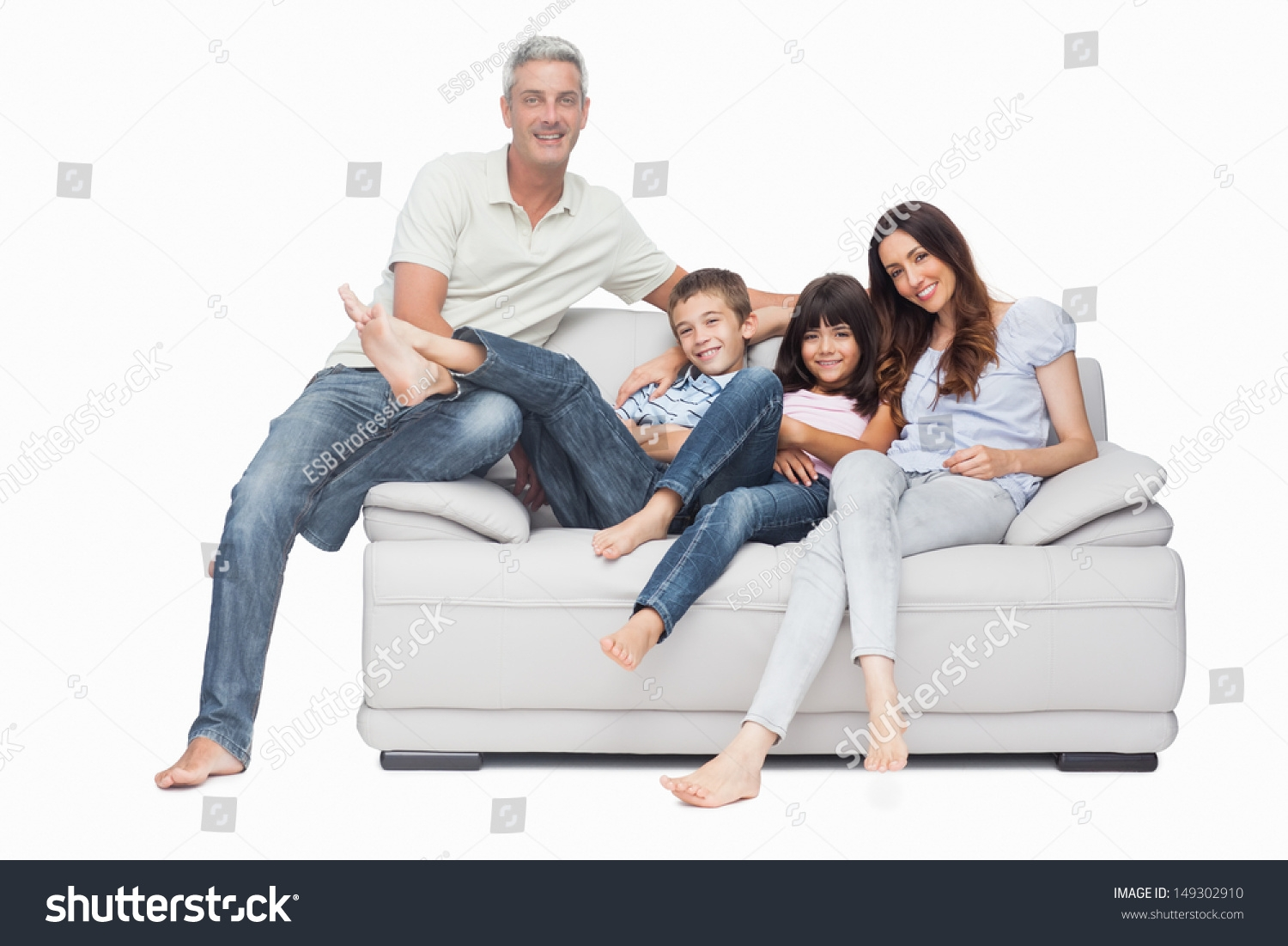 Family Sitting On Sofa Smiling Camera Stock Photo 149302910 Within Family Sofa (View 5 of 15)