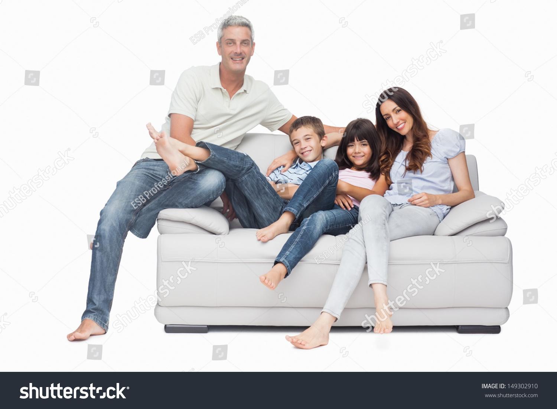 Family Sitting On Sofa Smiling Camera Stock Photo 149302910 Within Family Sofa (Image 5 of 15)