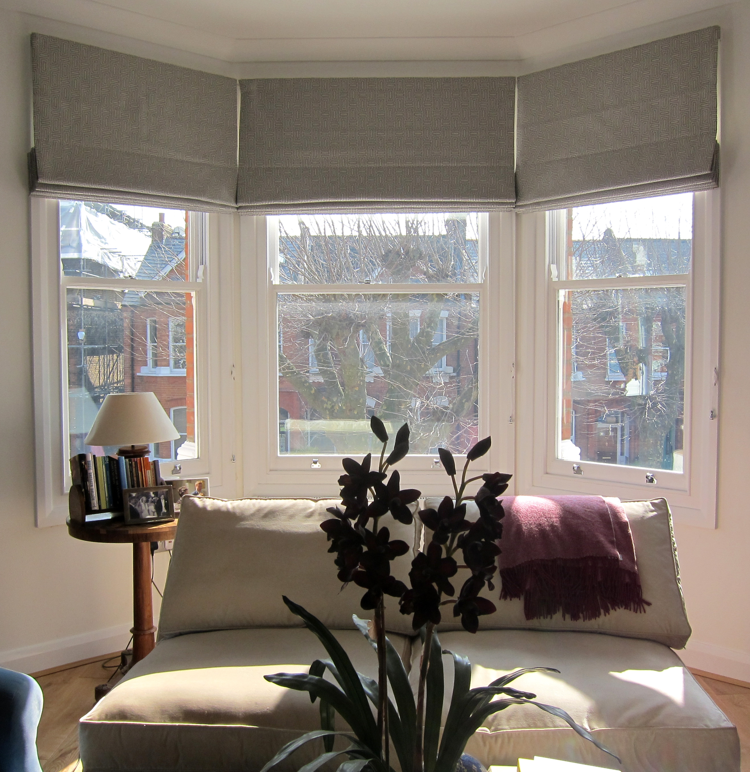 Geometric Patterned Roman Blinds In A Bay Window Could Work In Intended For Black And White Roman Blinds (Image 12 of 15)