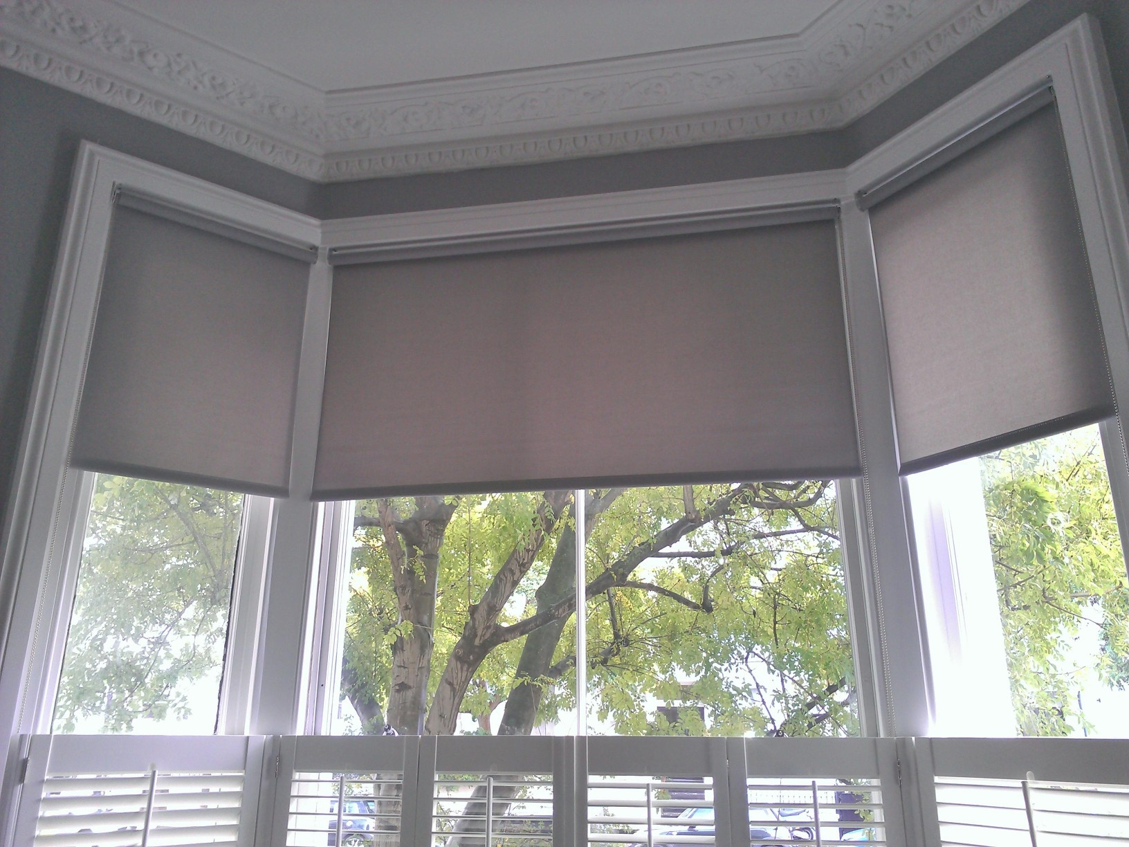 Geometric Patterned Roman Blinds In A Bay Window Could Work In Intended For Roman Blinds On Bay Windows (Image 7 of 15)