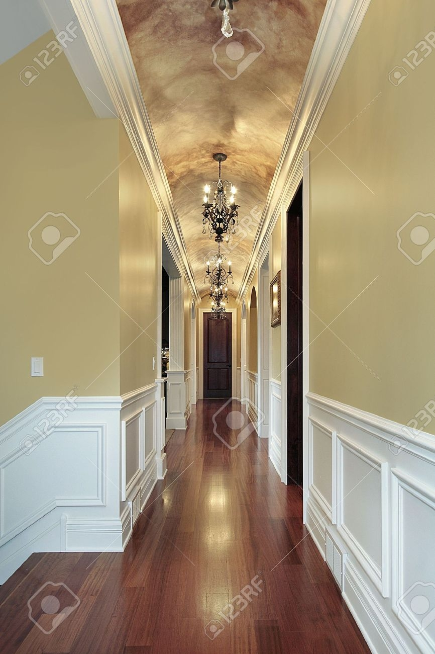 Hallway With Chandeliers In Luxury Suburban Home Stock Photo Intended For Chandeliers For Hallways (Image 11 of 15)