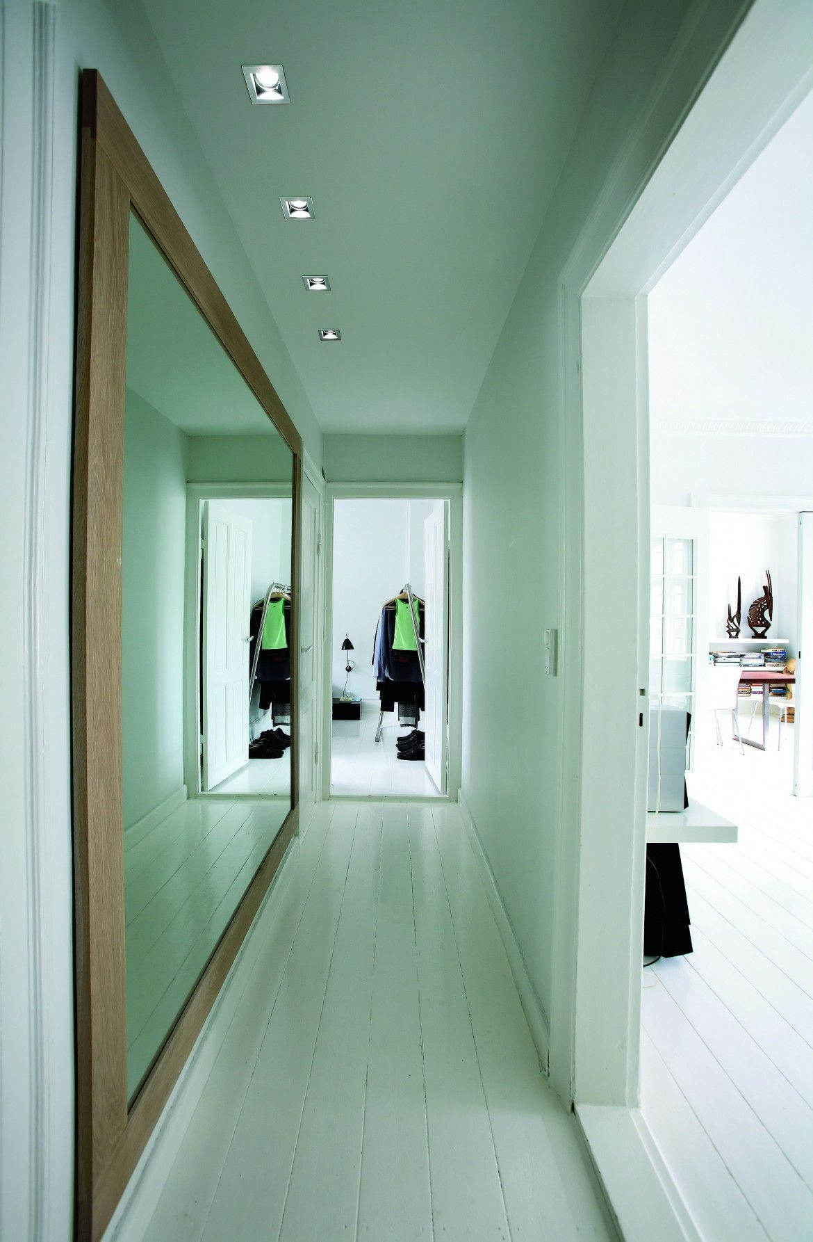 Hallway With Large Framed Wall Mirror In White Walls Hallway Pertaining To Large Hallway Mirror (Image 7 of 15)