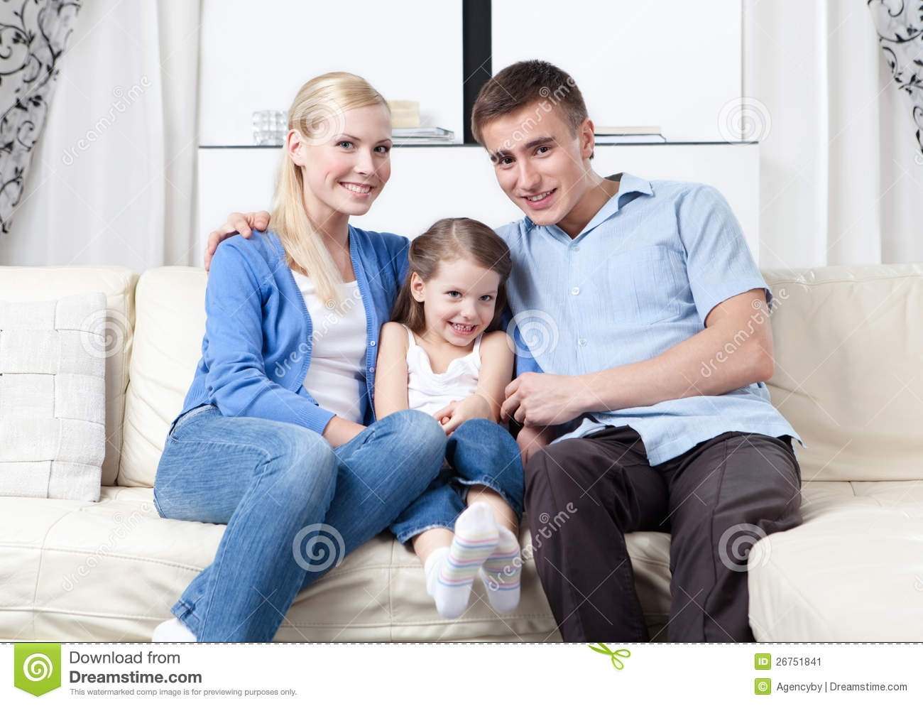 Happy Family Hug Each Other On The Sofa Stock Image Image 26751841 Regarding Family Sofa (Image 8 of 15)