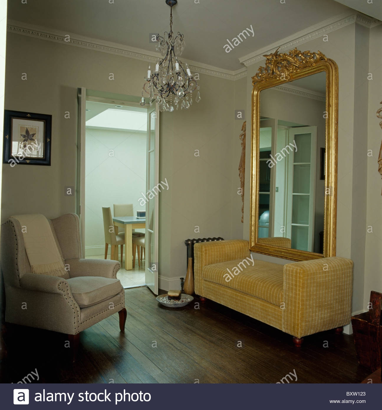 Large Ornate Antique Gilt Mirror Above Beige Velvet Sofa In Living With Regard To Ornate Gilt Mirrors (Image 9 of 15)