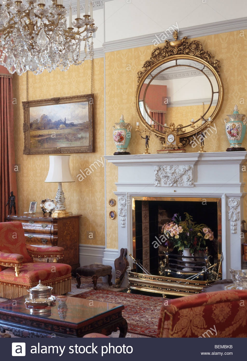 Large Ornate Antique Gilt Mirror Above Beige Velvet Sofa In Living Within Ornate Gilt Mirrors (Image 10 of 15)