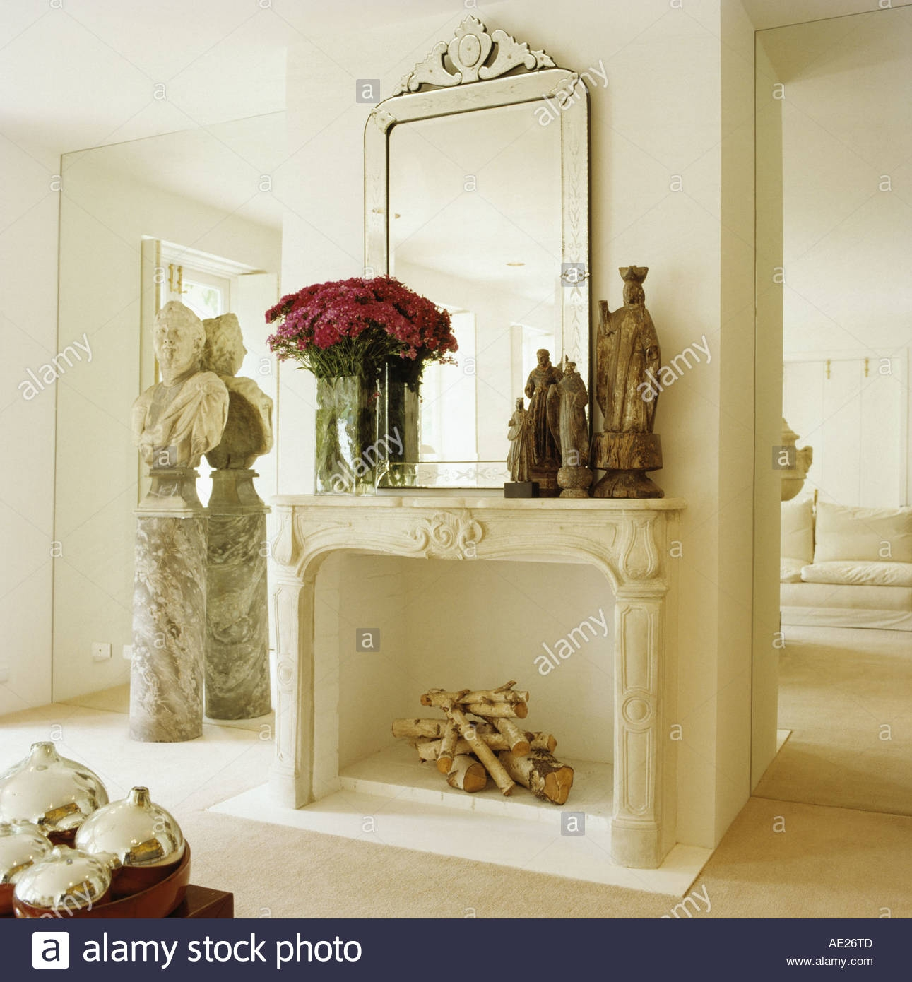 Large Venetian Glass Mirror Above Group Of Statues And Vase Of In Large Pink Mirror (View 12 of 15)