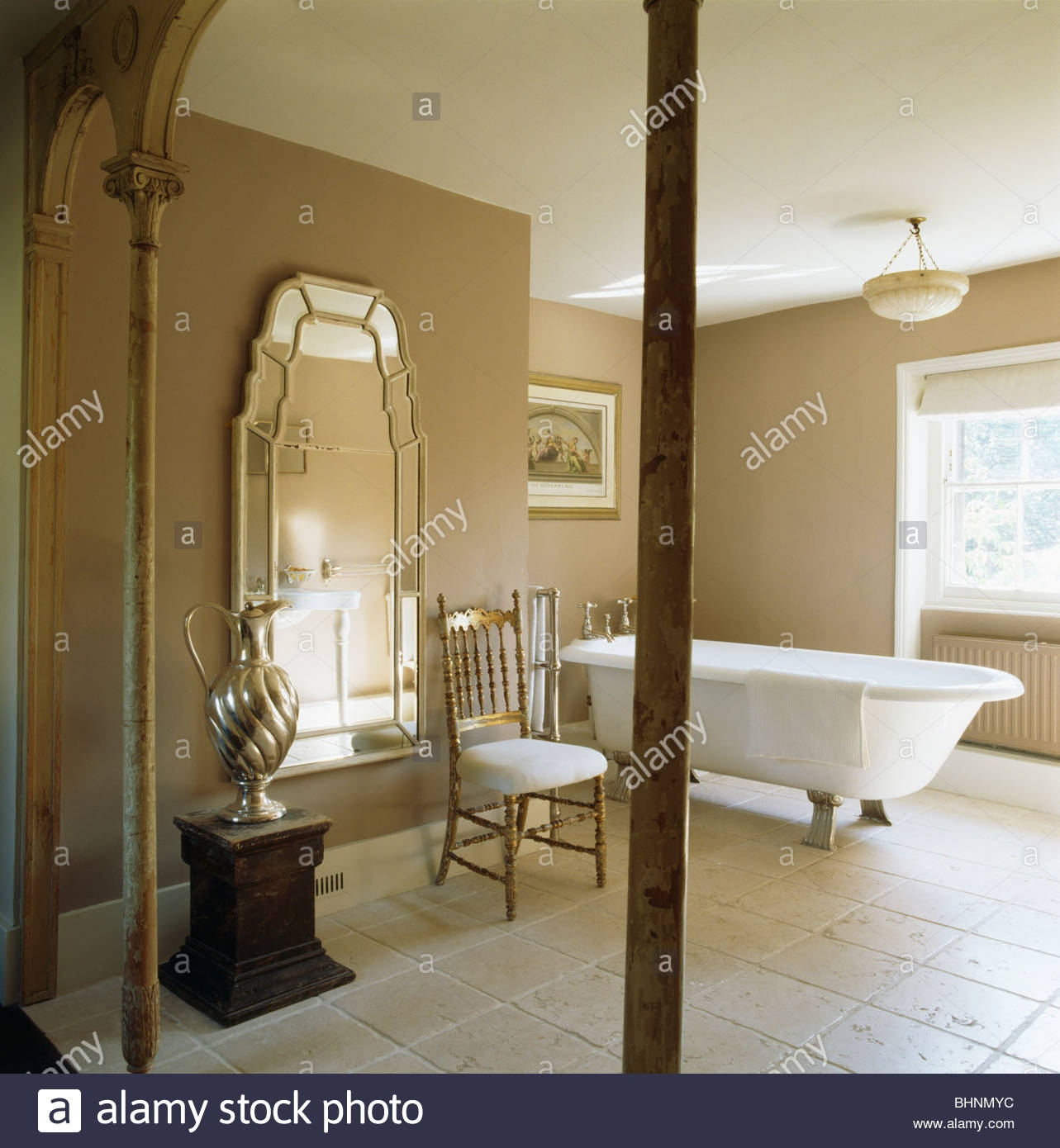 Large Venetian Mirror And Roll Top Bath In Beige Bathroom With Throughout Venetian Mirror Bathroom (Image 11 of 15)