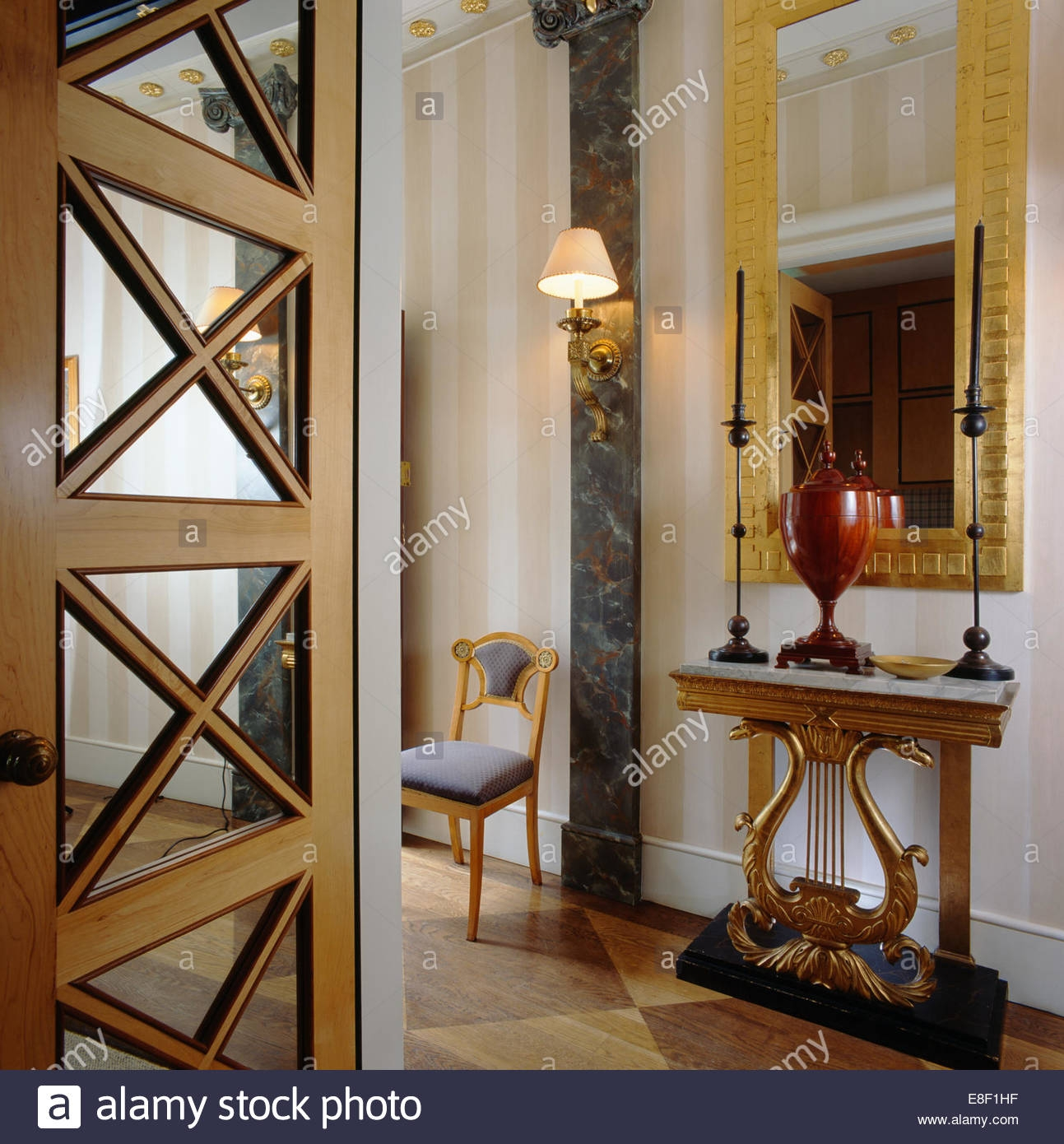 Mirror Above Ornate Console Table With Tall Candles In Elegant Pertaining To Tall Ornate Mirror (Image 10 of 15)