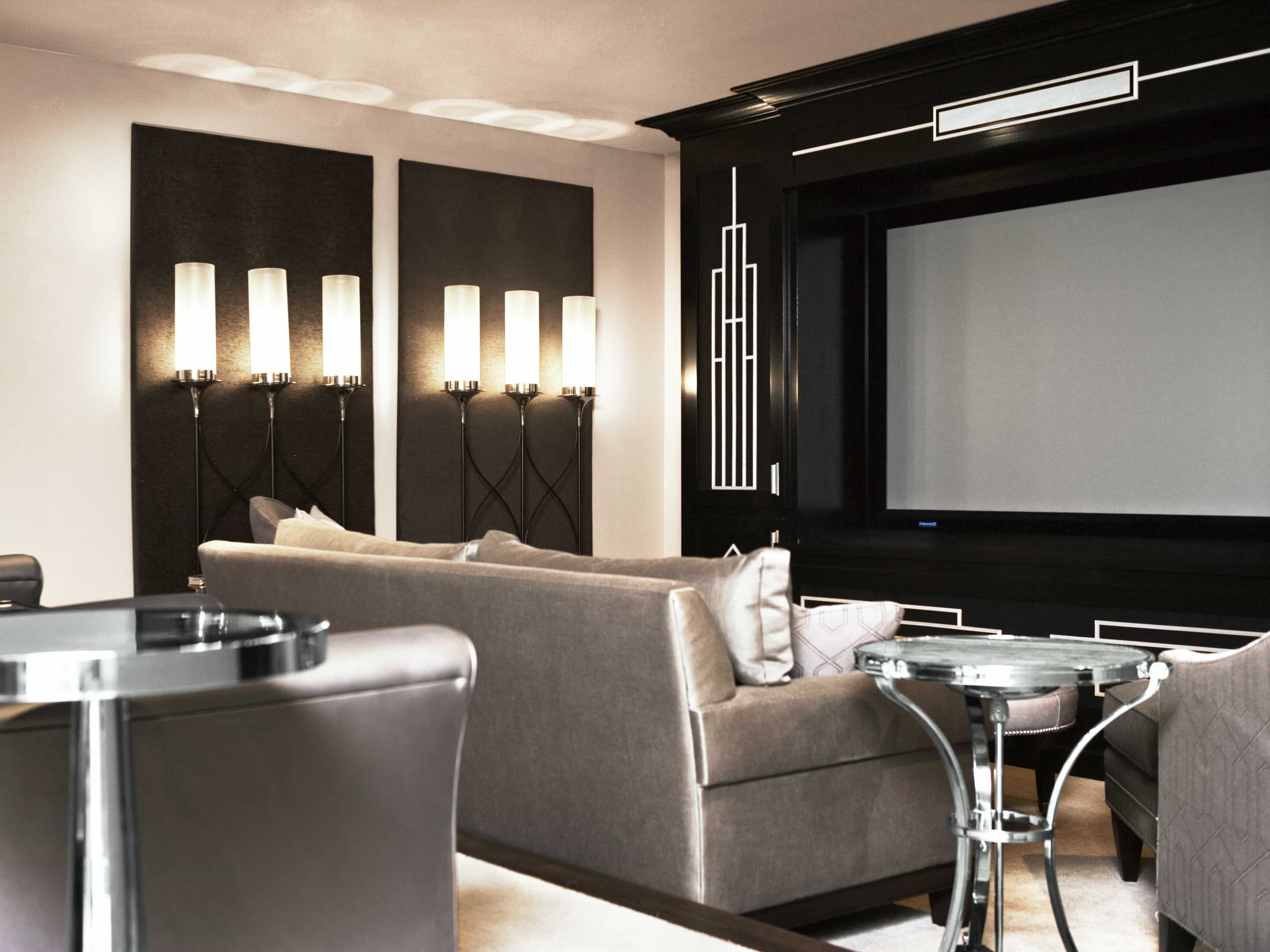 Modern black and silver home theater with uplighting for Living room uplighting