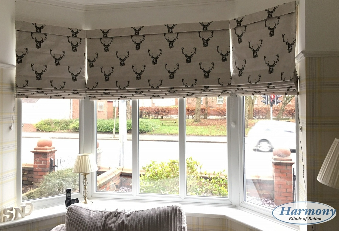 Patterned Roman Blinds In A Bay Window Harmony Blinds Of Bolton Regarding Bay Window Roller Blinds (Image 5 of 15)