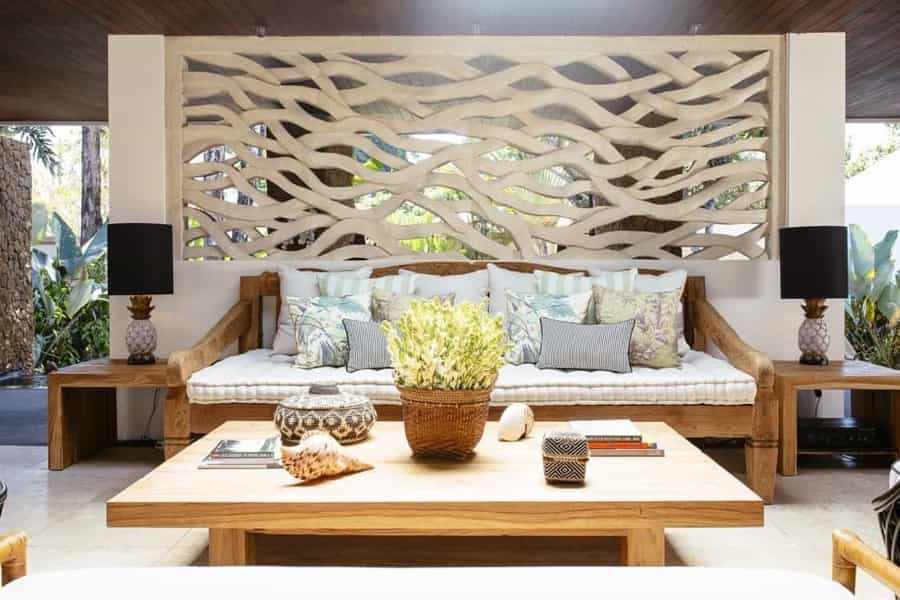 Featured Image of Plethora Of Pillows And Cushion Top Wooden Sofa In Outdoor Living Space