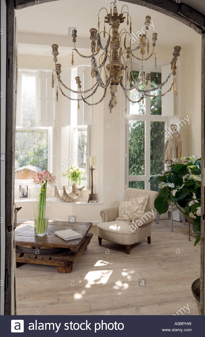 Room View Of White London Interior With Scrubbed Timber Floor And With French Wooden Chandelier (Image 14 of 15)