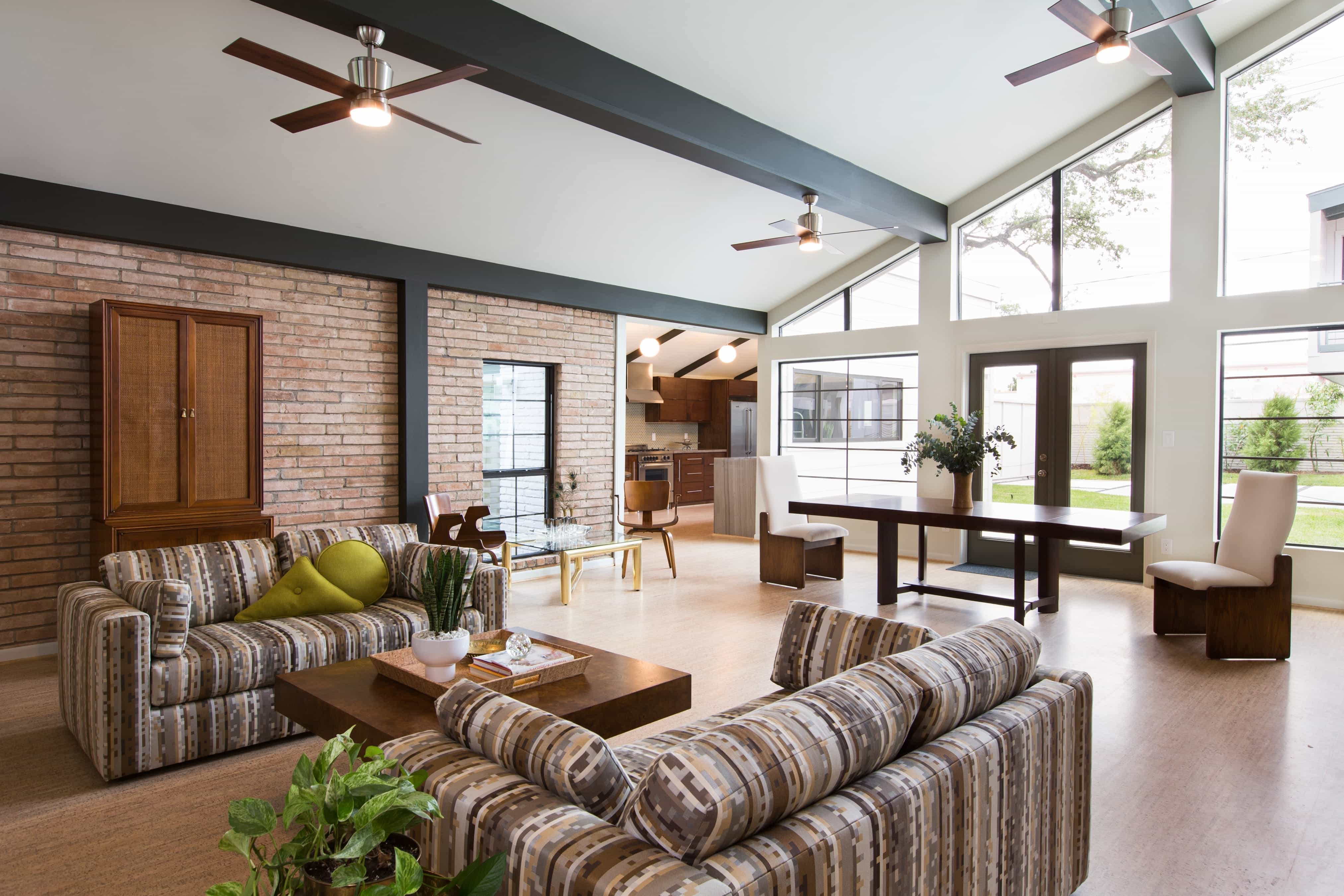 Spacious Modern Living Space With Vaulted Ceiling And Brick Wall (Image 25 of 30)