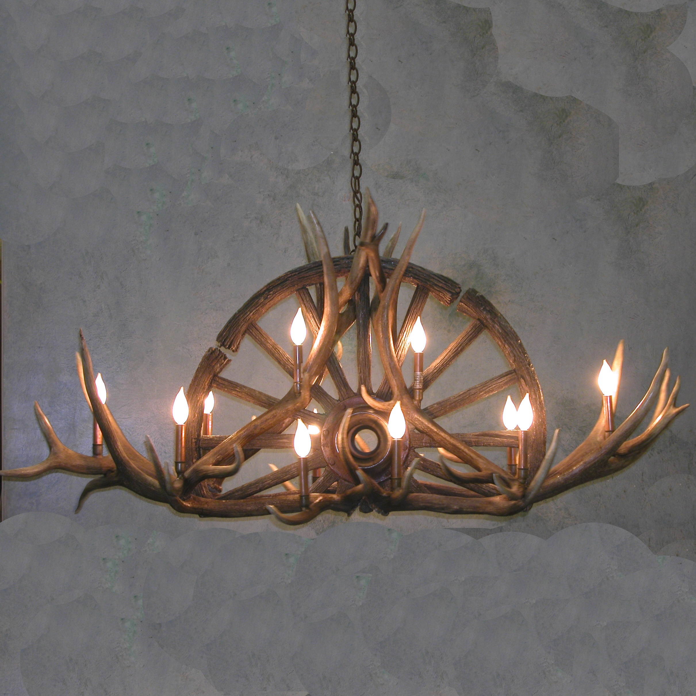 Sundial Wagon Wheel Antler Chandelier Throughout Antlers Chandeliers (Image 12 of 15)