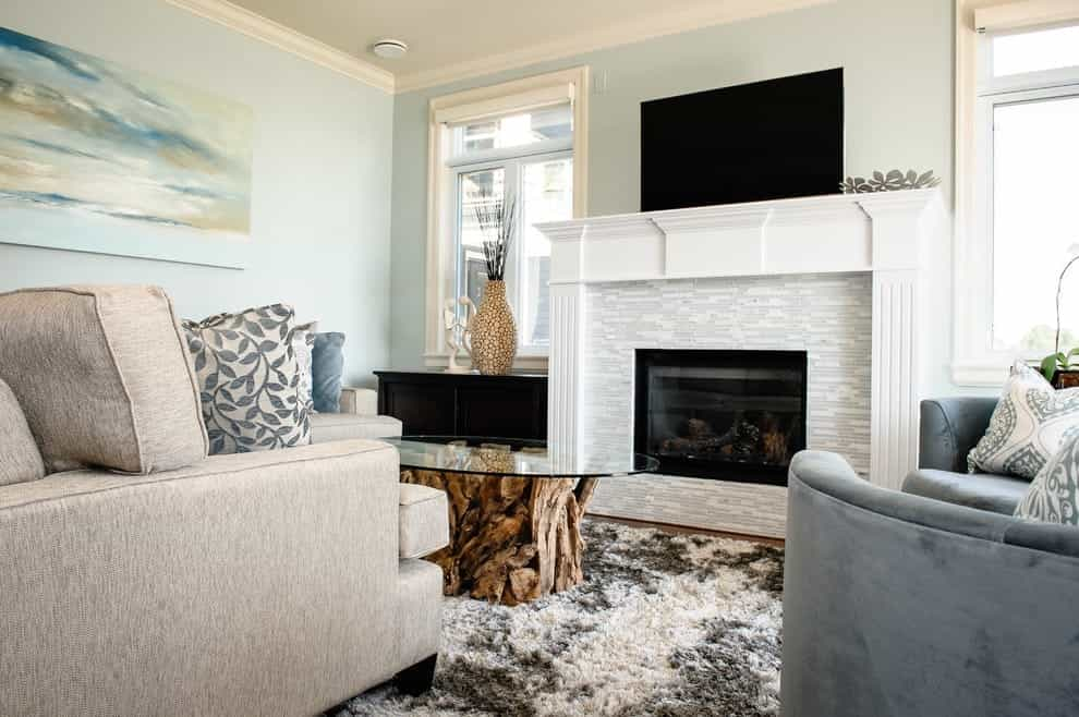 traditional living room with ceramic wall tiles in fireplace photo 1