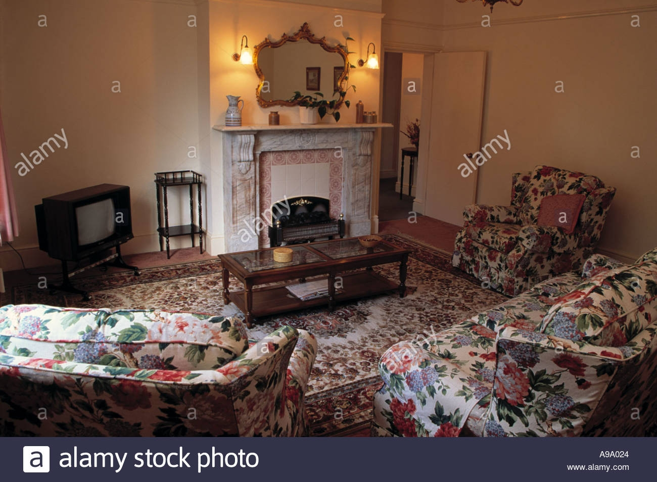 Chintz Sofa And Armchairs In Dated Living Room With Television In For Chintz Sofas (Image 1 of 15)