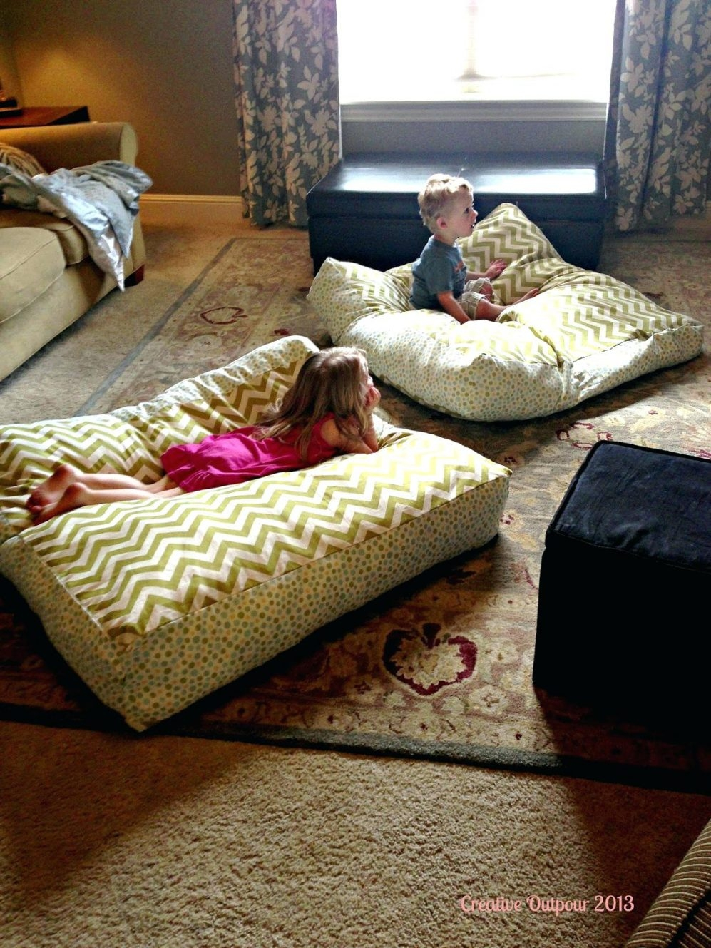 15 photos moroccan floor seating cushions sofa ideas for Floor cushion seating ideas