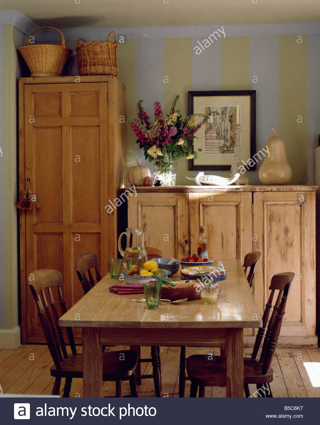 Wooden Table And Chairs In Country Dining Room With Wooden With Regard To Table Cupboards (Image 25 of 25)