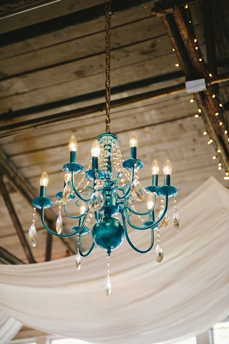 A Cheery Wedding With A Turquoise Orange And Yellow Color Palette With Regard To Turquoise Color Chandeliers (View 5 of 25)