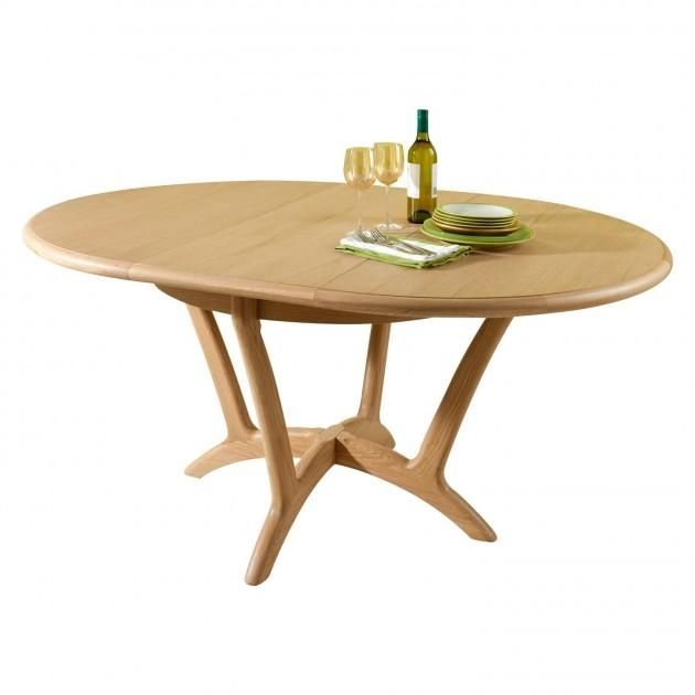 Dining Tables: Cozy Extendable Round Dining Table Designs Throughout Round Dining Tables Extends To Oval (Image 8 of 20)