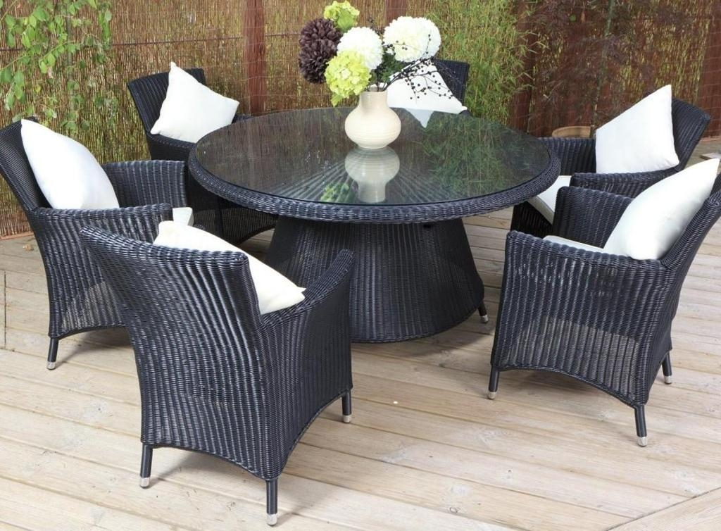 Great Looking Outdoor Dining Room With Square White Cushion And In Wicker And Glass Dining Tables (Image 11 of 20)