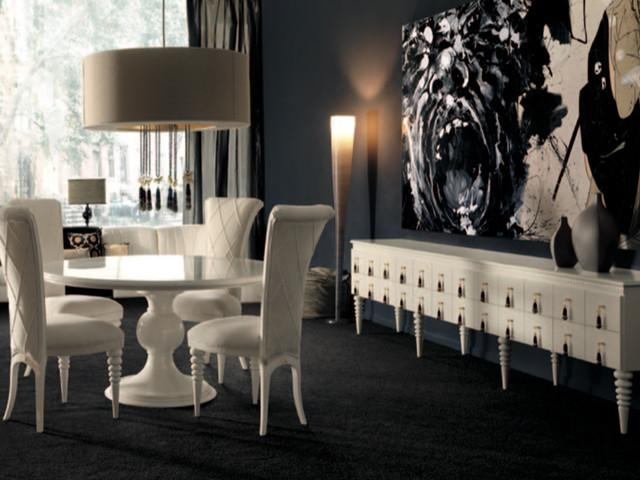 White Round Dining Table In A Dark Dining Room Pertaining To White Circle Dining Tables (Image 18 of 20)
