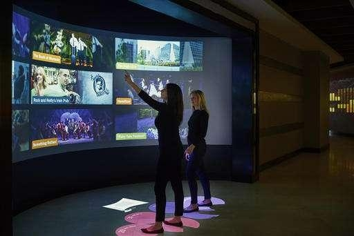 Digital Walls Offer Art And Info In Hotel Lobby Within Electronic Wall Art (Image 11 of 20)