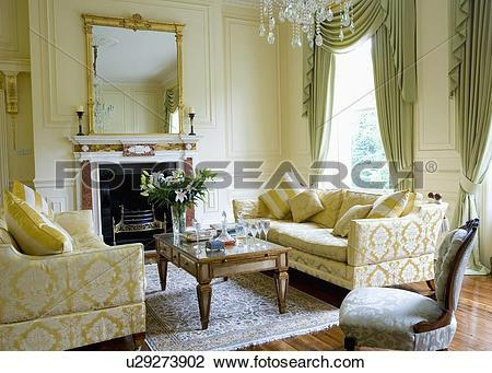 Stock Photo Of Cream Brocade Sofas And Glass Topped Coffee Table Throughout Brocade Sofas (Image 17 of 20)
