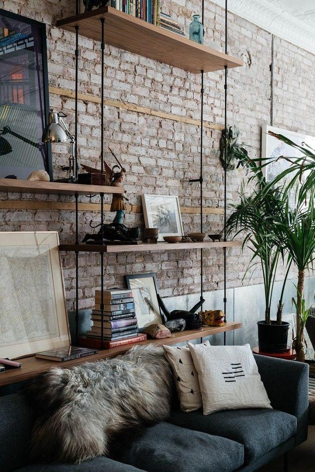 13 Creative Ideas For Decorating With An Exposed Brick Wall Pertaining To Hanging Wall Art For Brick Wall (Image 2 of 20)